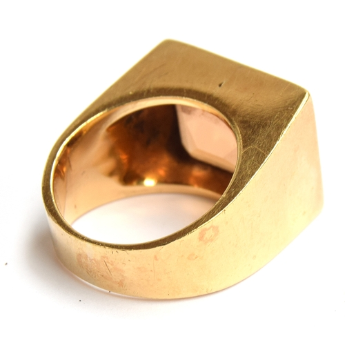 12 - A 1970s American mens gold signet ring, tested as 18ct, set with large quartz stone (possibly citrin...
