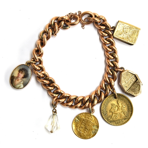 14 - A 9ct gold charm bracelet with 6 charms to include a gold quarter sovereign, 1920 France, small enam...