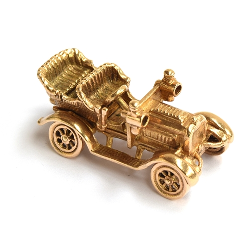 15 - A 9ct gold car bracelet charm in the form of a vintage car, gross weight 11.2g...