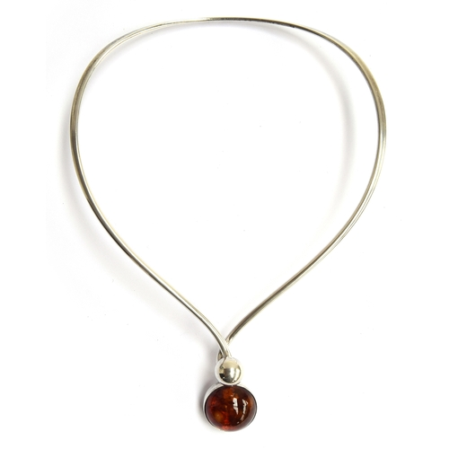 21 - A Danish sterling silver necklace with an amber centrepiece, marked with the maker NE FROM, 925S, gr...