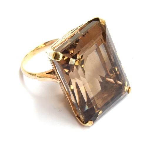 5 - A 9ct gold smokey quartz ring, size P, gross weight 19.8g...