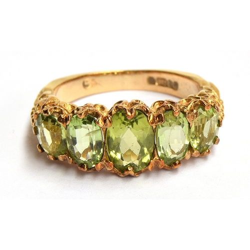 6 - A 9ct gold dress ring set with 5 peridots, size L, 4.2 gross weight...