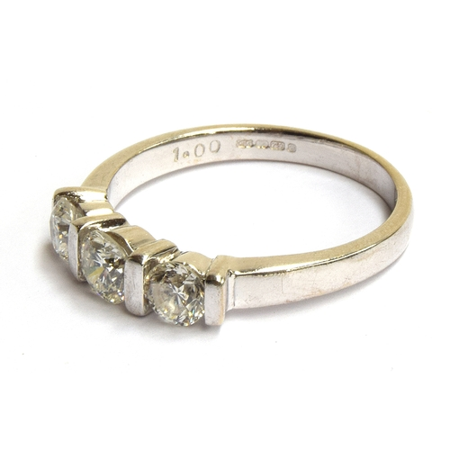 1 - An 18ct white gold ring with 3 old cut diamonds totaling approx 1ct, size Q, gross weight 4g...