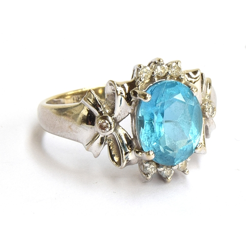 7 - A 9ct gold white gold dress ring set with a blue stone and small diamonds, gross weight 2.9g, size K...