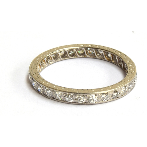 9 - Platinum (tested, no visible mark) eternity ring set with diamonds, size Q, gross weight 3.8g...