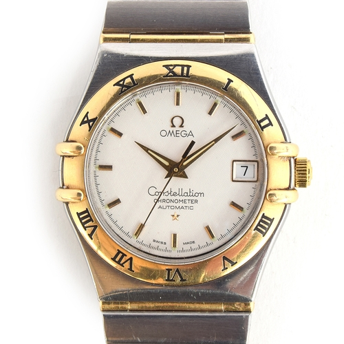 45 - A GENTLEMAN'S STAINLESS STEEL AND 18CT GOLD OMEGA CONSTELLATION BRACELET WATCH Circa 2000, WHITE SIL...