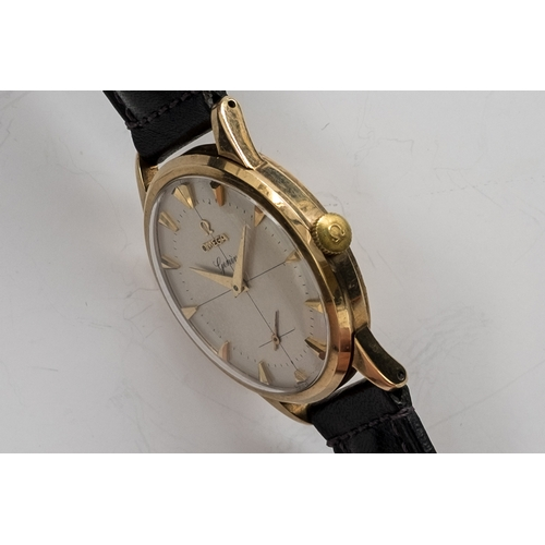 55 - A GENTLEMAN'S 9CT GOLD OMEGA GENEVE WRIST WATCH DATED 1956, SILVER TWO-TONE CROSS HAIR DIAL, DAUPHIN...
