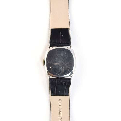 58 - A GENTLEMAN'S STAINLESS STEEL OMEGA WRIST WATCH DATED 1934, parchment dial with arabic numerals, rai...