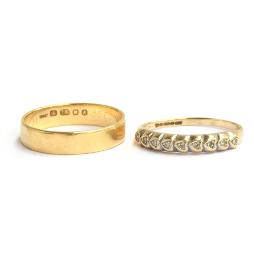 11 - A gold ring (marks indistinct) with 9 heart shaped settings inlaid with small diamonds, size N and a...
