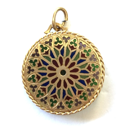 33A - Gold pendant with faded marks (tests as 18ct) in a round filigree form inset with coloured stones/gl...