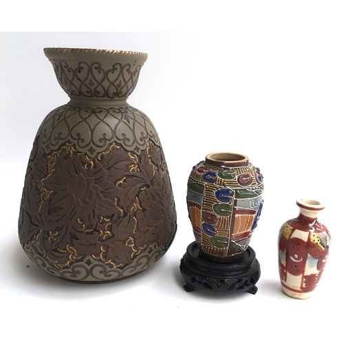 39 - Two small antique Japanese vases, one with carved stand; together with a large Oriental style vase w...
