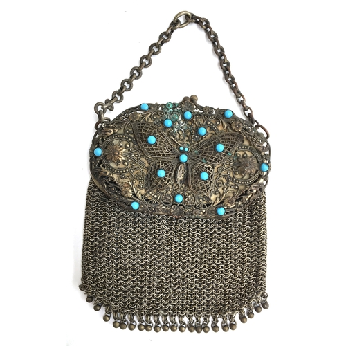 32 - A metal and turquoise filigree lady's purse...