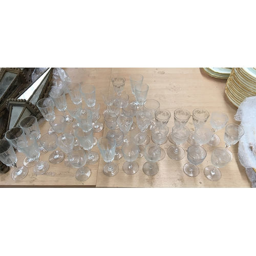 39 - A group of early 19th century port glasses with grape and vine etching (11), and others similar...