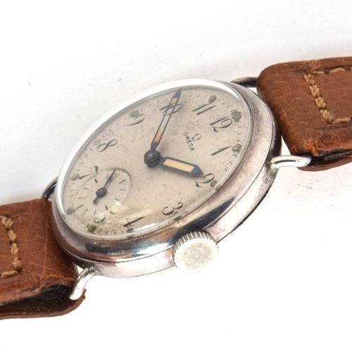 532 - AN OMEGA SILVER GENTLEMAN'S WRIST WATCH Circa 1920s, white dial with painted Arabic numerals Movemen...