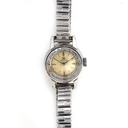 534 - AN OMEGA LADIES SAPHETTE STEEL WATCH Silvered dial with raised baton markers, diamond cut crystal gl...