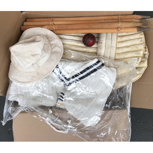 56 - A 1970s red leather cricket ball, two sets of stumps, cricket pads, and Middlesex cricket club team ...