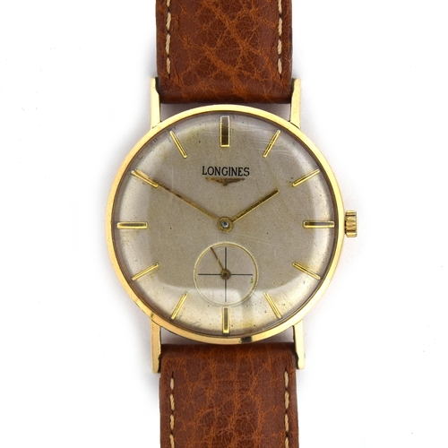 575 - A LONGINES 9CT GOLD GENTLEMAN'S MECHANICAL WRIST WATCH Circa 1950s, cream dial, raised gold baton ma...