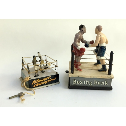41 - Boxing interest, a cast iron novelty 'Boxing Bank', 21cmH; together with 'Slugger Champions' wind up...