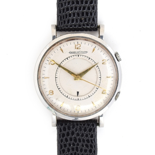 561 - A JAEGER LECOUTRE MEMOVOX STEEL GENTLEMAN'S MECHANICAL WRIST ALARM White dial, Arabic numbers on eve...
