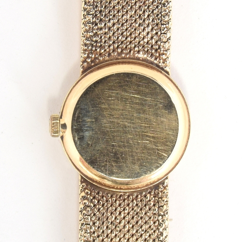 530 - AN OMEGA 9CT GOLD LADIES WRIST WATCH DATED 1968, silvered dial, gold baton markers, straight black h...