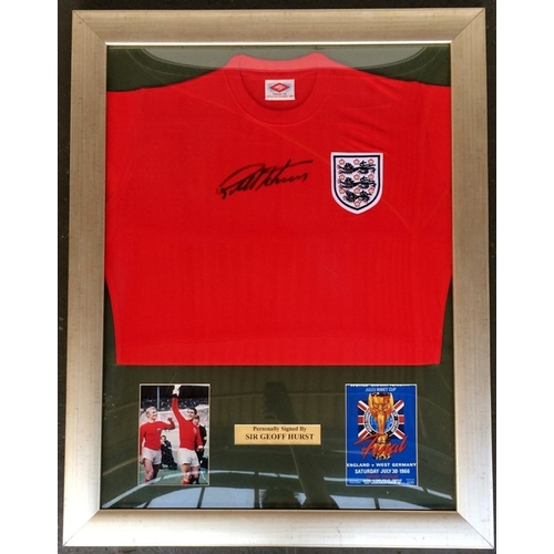 51A - A framed display of a 1966 World Cup replica shirt signed by Geoff Hurst, in black permanent marker ...