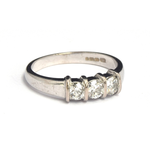 5 - An 18ct white gold diamond ring featuring three round cut diamonds, approx. 60 carat, gross weight 4...