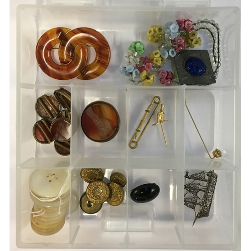 29 - Mixed lot to include amber buttons, a white metal filigree brooch of a ship, buttons, marked Gardin ...