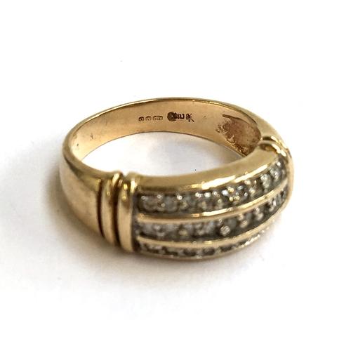 14 - A 9ct gold three row diamond ring, 4.1g...