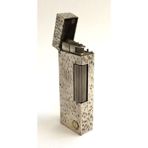 39 - A silver plated Dunhill Rollagas lighter, with bark effect finish, 6.3cmH...