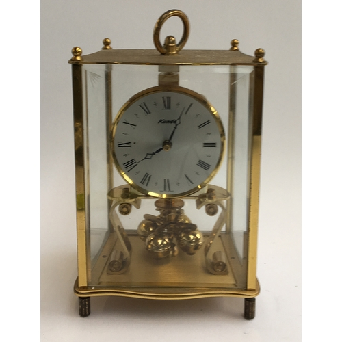 51 - A Kundo gilt metal mantel clock...