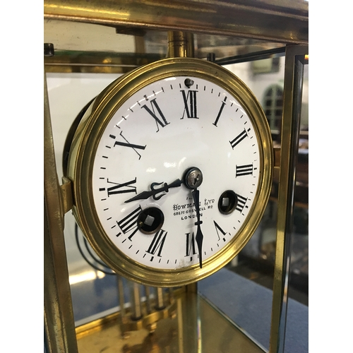 50 - A gilt metal mantel clock by Bowman Ltd, 68 & 70 Coswell Road, London, engraved 'Presented to Mr W.H...