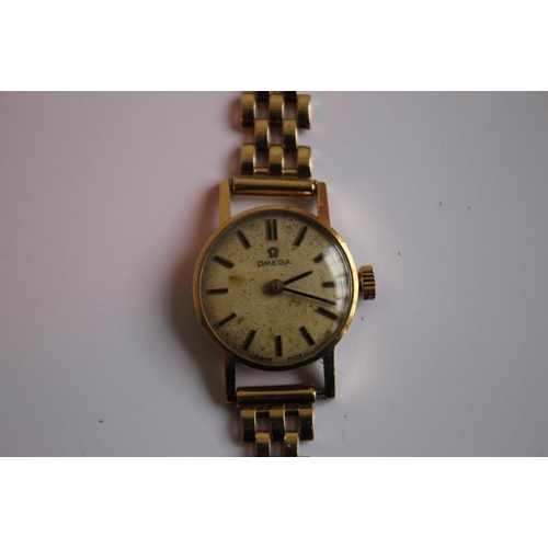10 - A LADIES OMEGA MANUAL WIND WRIST WATCH on an unbranded 9 ct gold strap, dedication inscription to th...