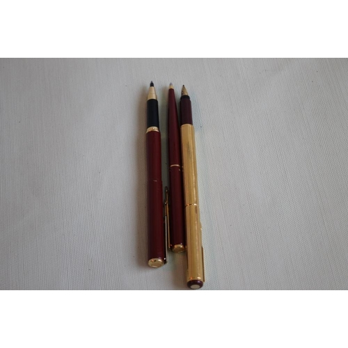 17 - A PARKER 88 MAROON & GOLD FOUNTAIN PEN, gold plated (1988) together with two Parker Imperial Line (Y...