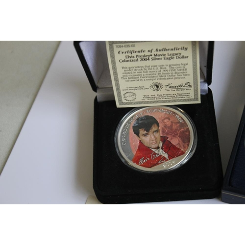 40 - ELVIS PRESLEY INTEREST- TWO COLORIZED SILVER 1OZ SILVER EAGLE WITH CERTIFICATE OF AUTHENTICITY, A CA...