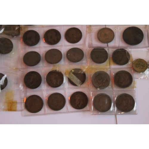 44 - A WOODEN BOWL OF BRITISH AND WORLD COINS