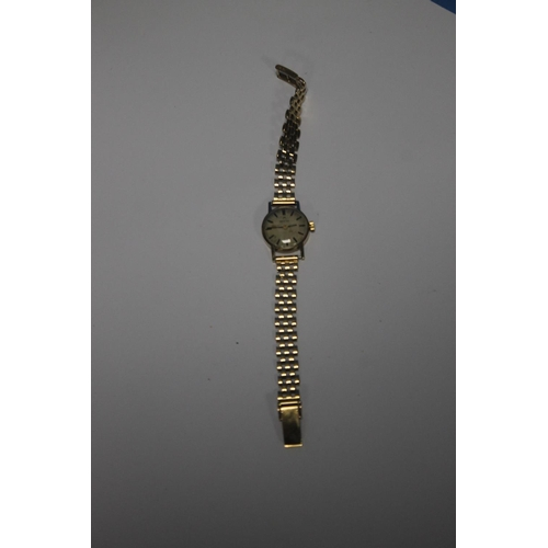 24 - A LADIES OMEGA MANUAL WIND WRIST WATCH on an unbranded 9 ct gold strap, dedication inscription to th...
