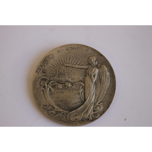 50 - A 1903 JOSEPH CHAMBERLAIN VISIT TO SOUTH AFRICA SILVER MEDAL, along with a South Africa 1952 crown, ...