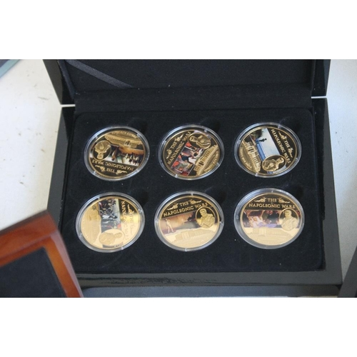 59 - A COLLECTION OF BOXED COMMEMORATIVE COINS, to include three Edward VIII retro sets, a set of St Hele...