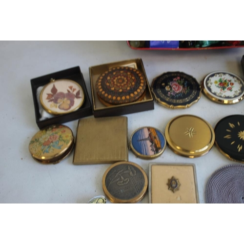 9 - A BOX OF CURIOS, to include 16 compacts, enamel pin badges, pen knives, compass etc