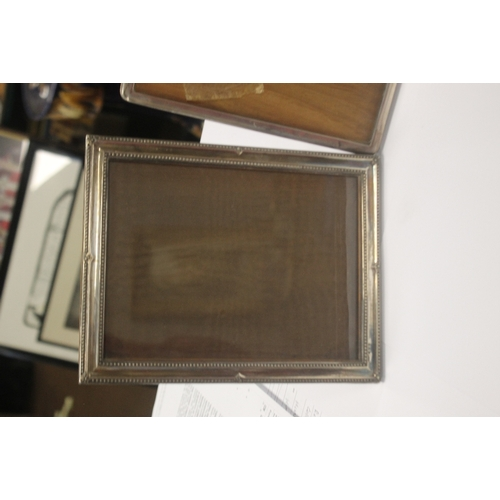 3 - TWO HALLMARKED SILVER PICTURE FRAMES together with a white metal frame, the largest 23 x 17.5 cm
