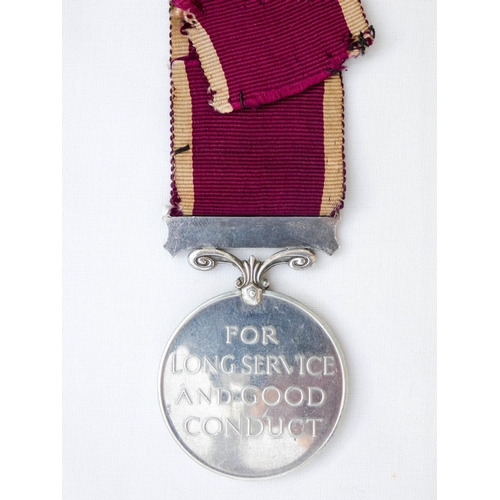 517 - The Army Long Service and Good Conduct Medal with regular army bar, awarded to 1056349 Bombardier A ...