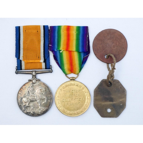 536 - A First World War pair of medals to 61335 S Gotts of the Royal Artillery together with his dog tags...