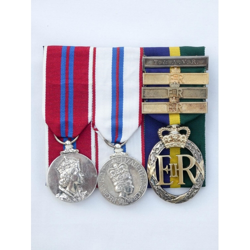 554 - An unnamed group of three medals to include a 1953 Coronation, 1977 Silver Jubilee Medal and the Eff...