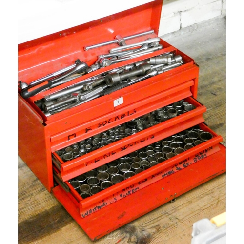 1 - A red metal tool box with three trays containing hundreds of sockets and one tray containing a very ...