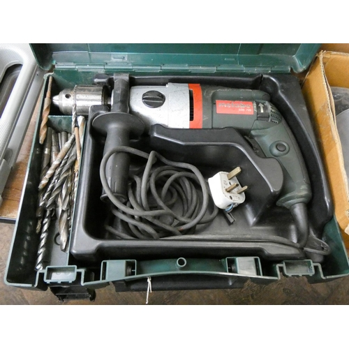 49 - A Metabo heavy duty electric hammer drill...
