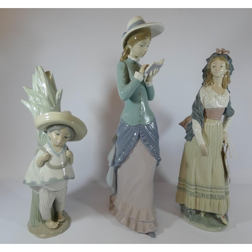 506 - Three Lladro porcelain figurines, two of ladies and another of a Mexican style boy, tallest measures...