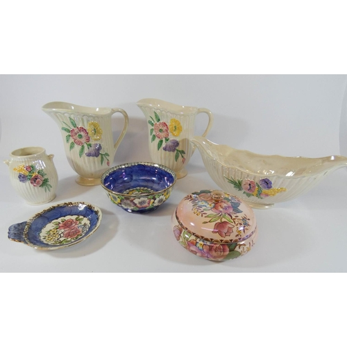 516 - A collection of seven Maling lustrous glazed china pieces - pair of jugs, powder bowl etc...