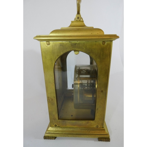 517 - Brass mantel clock with arched top and glazed sides, with presentation plaque to back panel - Courta...