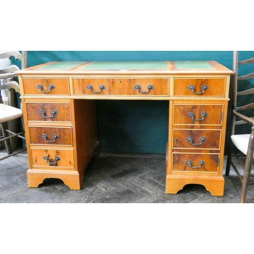 1 - A Georgian style yew wood twin pedestal office desk fitted six drawers and cupboard with green leath...