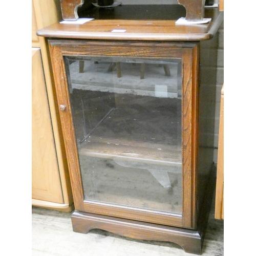 19 - An Ercol oak glazed HiFi cabinet...